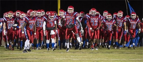 Pascagoula High School Football team in their red uniforms during a football game