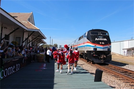 Amtrak train  with cheerleaders