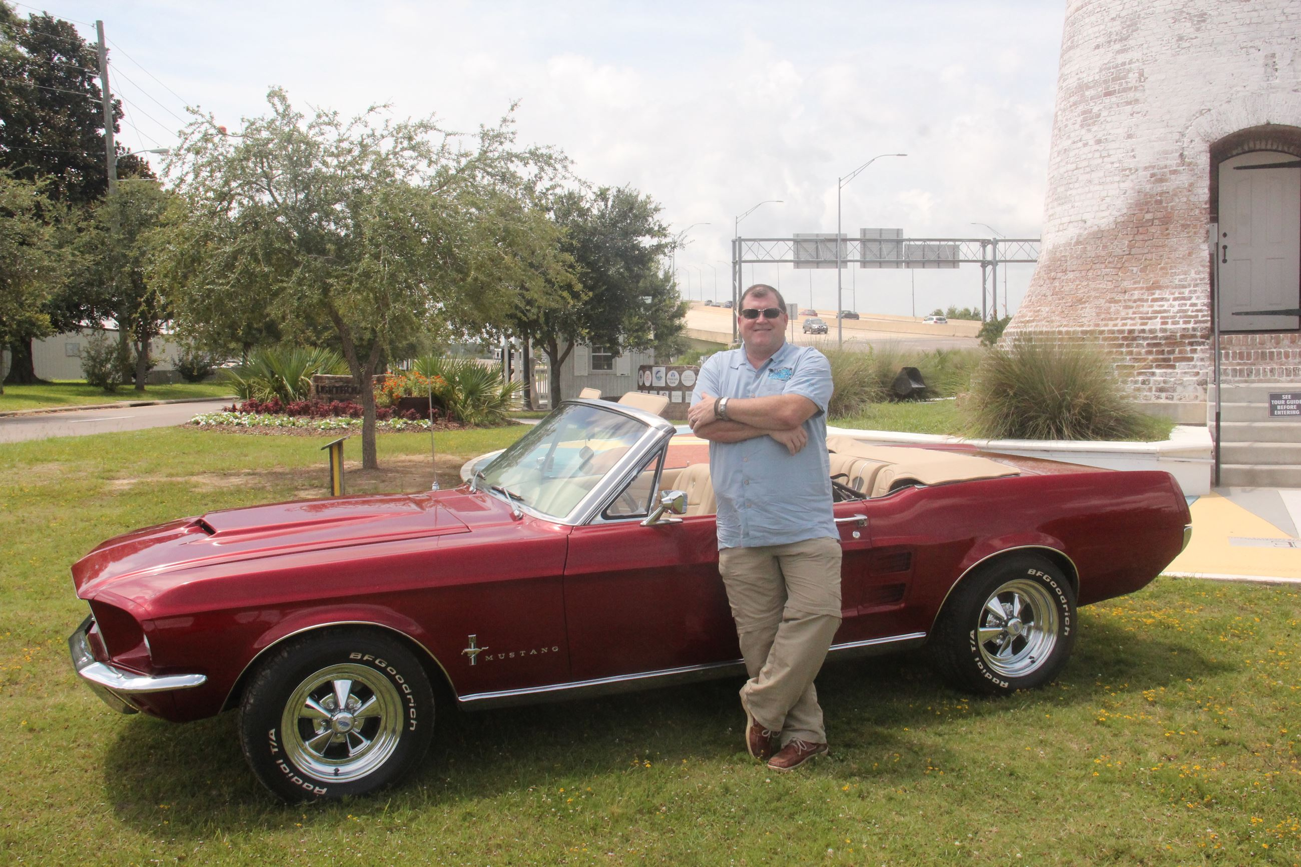 Mayor Maxwell with red mustang in front of the white lighthouse