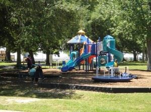 Beach Park, image of playground with children and families