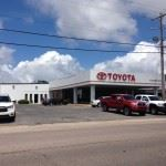 Image of Toyota car dealership with trucks out front